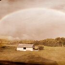 Rainbow on the hill by Donnalee