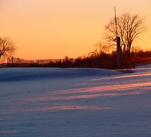 Winter Sunset Over the Snow by vigor