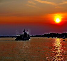 A  Riverboat  going into the sunset     by Rick  Todaro