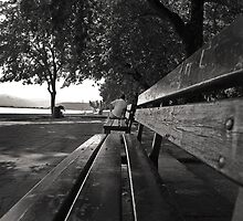 man in a bench by fanis logothetis
