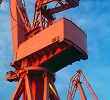Red dockyard cranes by Alex Ramsay