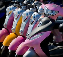 The Twins - Lovely group of colorful scooters on the beach by factor