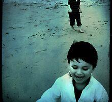 boys on the beach by Sonia de Macedo-Stewart