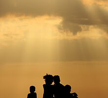 Family Watching Sunset by BGpix