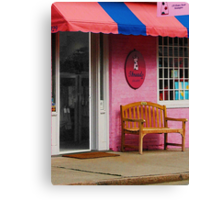Dress Shop With Orange and Blue Awning Canvas Print