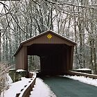 Covered bridge in winter by Sandy Hopkins