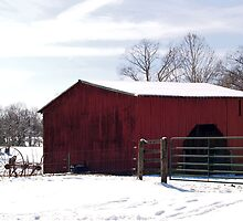 Old Red Barn with Farm Equipment in the Snow by BCallahan