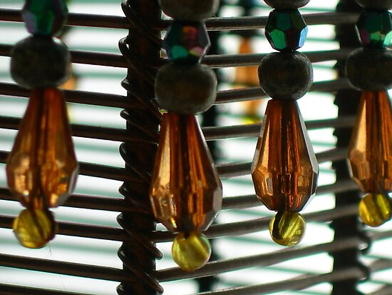 beads on a candle holder by Matte Downey