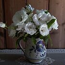 crisp white iceberg roses in Italian wine jug by BronReid