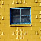 yellow wall/blue framed window by Lynne Prestebak