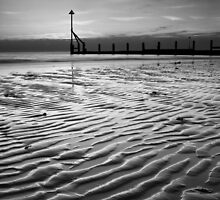 The sand rippled black and white by postmansmith