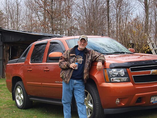 A man, his truck and his beer by Rob Dodd