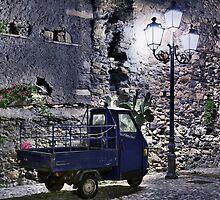 Three wheeler at night by Mario Curcio