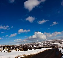 Snowy Scottish landscape with a road by Gabor Pozsgai