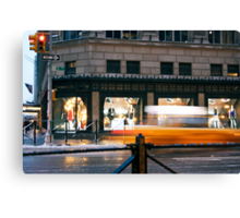 Saks 5th Avenue with Taxi...itsablurr Canvas Print