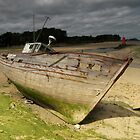 wood boat in the beach by seccotine
