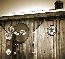 """Old Fire Chief Gas Pump In Sepia"" by franticflagwave"