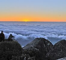 A photographer captures the sun setting over Table Mountain by davridan