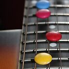 Smarties on Guitar Strings by Darsha Gillmore