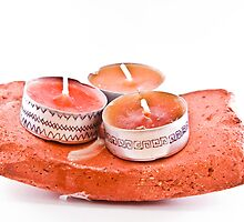 Hand-painted candles on a stone by Gabor Pozsgai