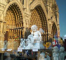 Reflections in a shop window, Amiens, France by buttonpresser