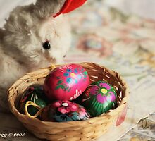 Easter Bunny inspects a basket of hand-painted wooden Czech Easter eggs by pogomcl