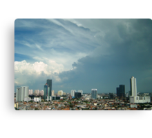 A tropical storm moves over the city Canvas Print