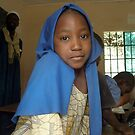 Gambian girl in blue by elisabeth tainsh