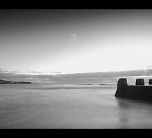 A New Dawn - The sun rises over Coogee Beach - Black & White by dahon