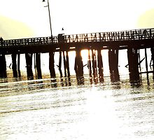 Sun through pier by Saltan