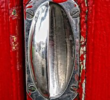 Handle on Telephone Box by Karen  Betts