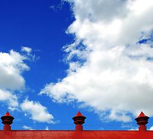 Clouds and 3 metal points to the sky by Mark Malinowski