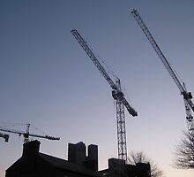 Cranes a work on a site Dublin by heartyart