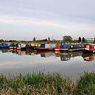 Narrowboats at Barton Marina by Rod Johnson