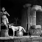 Bali Boy With Dog by Albert Sulzer