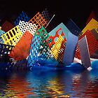 Colourful perforated metal mesh reflected in water. by Peter Stone