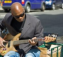 Playing bass on Northumberland Street by David  Parkin