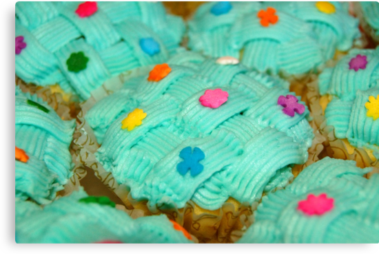 cupcake with green coating and sugar candies by walterericsy