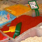 Vibrant coloured spices on the Leeds Kirkgate market by patjila