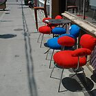 Red and blue chairs for sale by Larry McLean