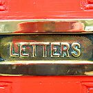 Brass letterbox & Red Door by buttonpresser