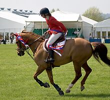 Show Jumper. The Winner. Lap of Honour. by Country  Pursuits