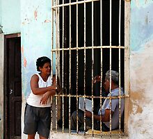 Couple chatting, Trinidad, Cuba by buttonpresser