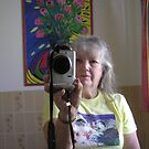 Gini.ginnymac ,does the self portrait reflection . by Virginia McGowan