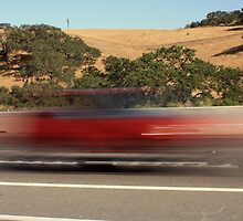 Red blur on the highway by gregorydean