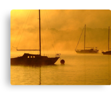 yacht at foggy sunrise Canvas Print