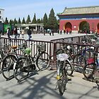 Bicycles at the southern entrance to the Temple of Heaven, Beijing, China by Philip Mitchell