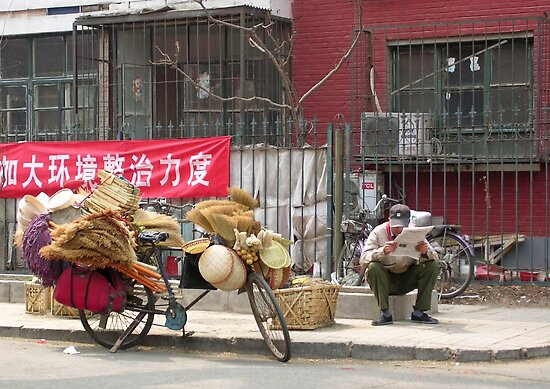 The brush-seller takes a break, Beijing, China by Philip Mitchell