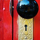 Black Knob On Red Door by JCBimages