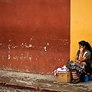 Vendor in Red and Gold, Antigua by morealtitude